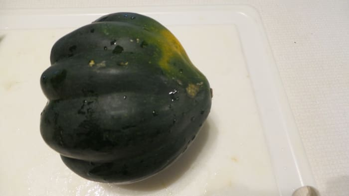Cut both ends of the acorn squash.