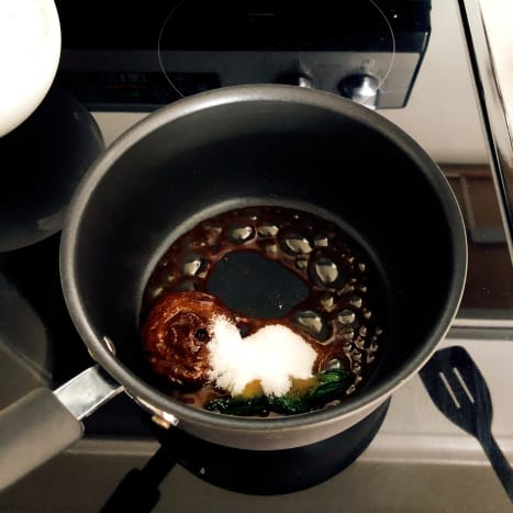 In a pan, throw in palm sugar, water, white granulated sugar, flour, and shredded coconut. Cook until sugar is dissolved.