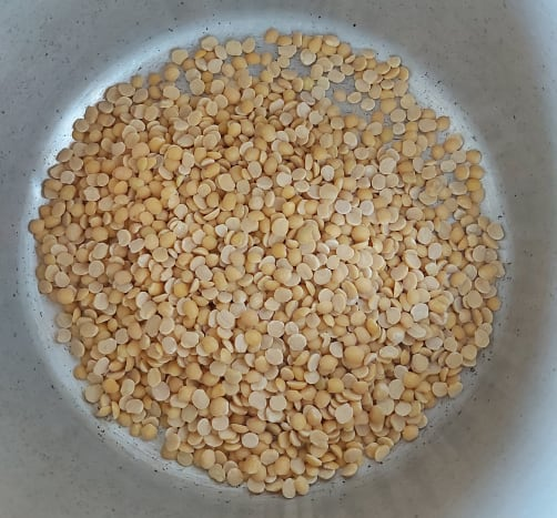 In a cooker, add 1 cup of dal. I used toor dal, but you can use moong dal, masoor dal or a mix.