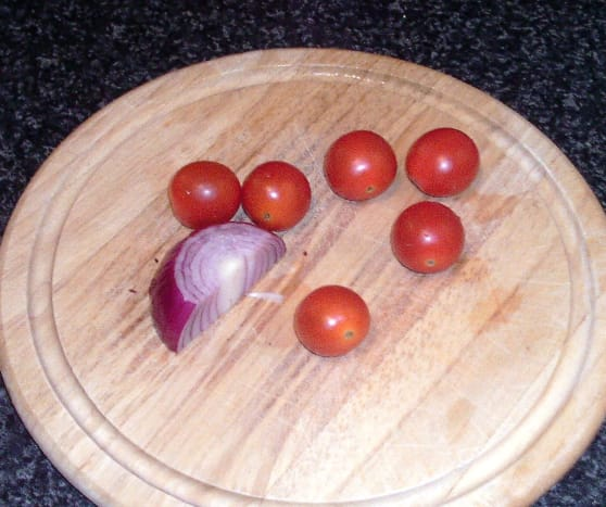 Cherry tomatoes and quarter red onion