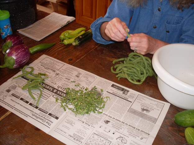 Snap the green bean ends, and remove strings as necessary. Discard any discolored, soft, or otherwise faulty beans.