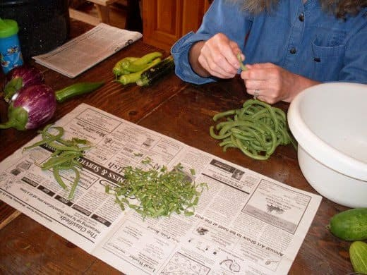 Snap the ends off the beans, and remove any strings. Break into pieces, if desired. If you like eating whole green beans, leave them whole.
