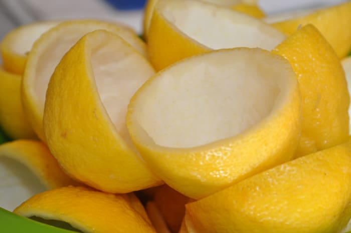 Step 1: Prepare the lemons. (Juiced lemon halves with pulp removed, ready for candying.)