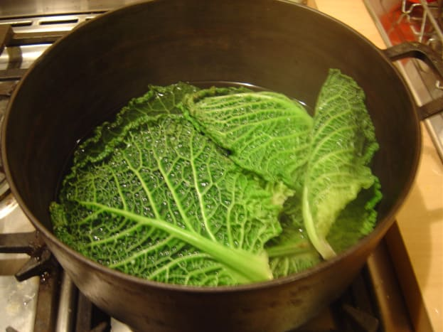 Boil the cabbage leaves.