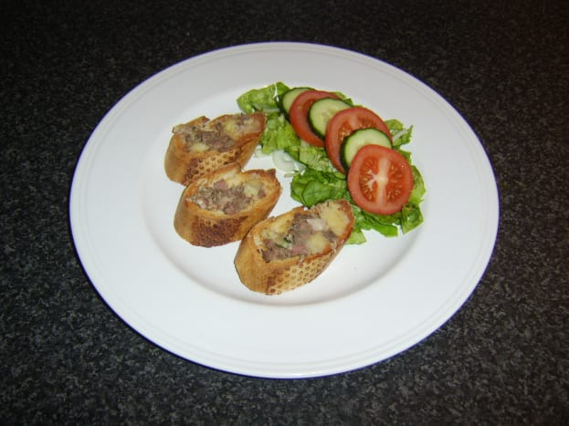 Chunky chicken liver pate served on hot toast with simple salad.