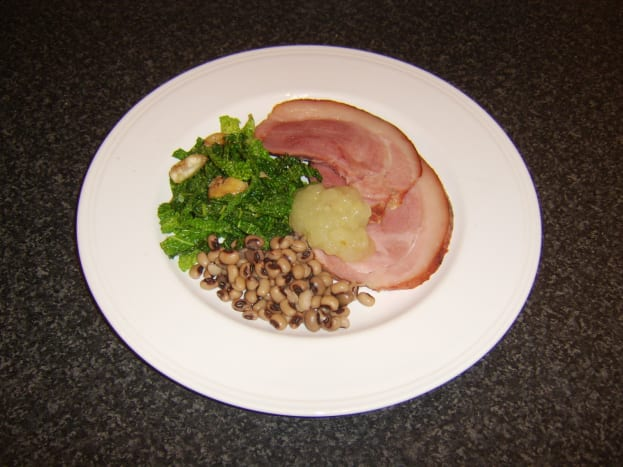 This three-times-lucky New Year dish incorporates roast ham, sauteed Savoy cabbage and black-eyed peas.