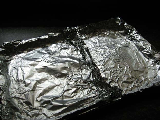 Use foil to make two sections in a large baking pan.