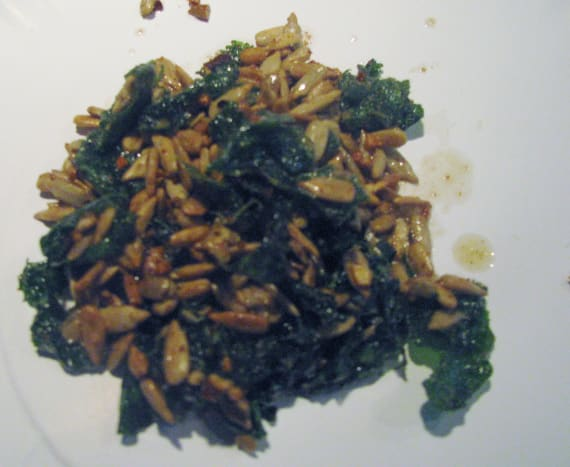 Sauteed radish greens with sunflower seeds. Red pepper flakes help to give it a spicy kick.