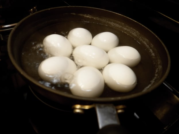 Step 1: Cover eggs with water in pan.  Put on stove.  Heat to boiling.  Boil 12 minutes. Take off the stove and pour off the hot water. Put eggs in ice water (which helps the shell to separate from the egg and makes peeling easier).