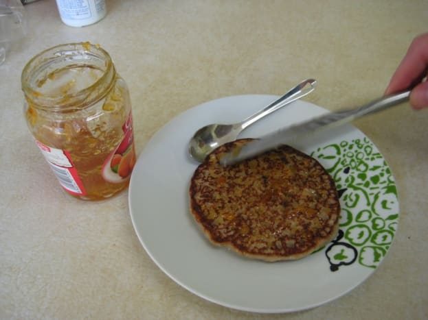 Spread on a generous amount of fruit jam or maple syrup.