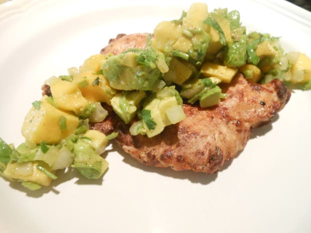 Mango and avocado salsa tastes great over grilled chicken.