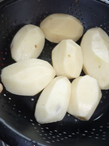 Peeled potatoes.  Rinsed & ready to cut.