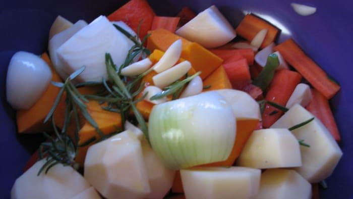 Preparing vegetables for roasting.
