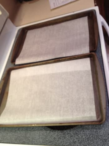 Line baking sheets with parchment paper.