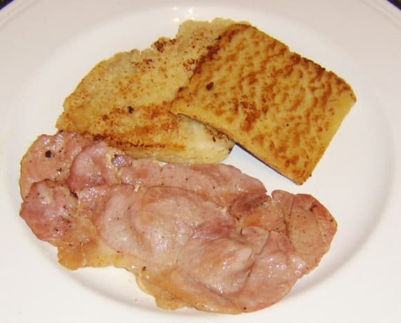 Potato and soda farls are plated with bacon