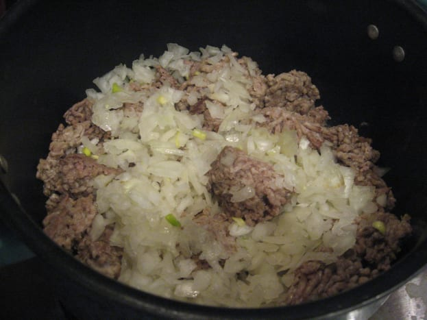 Cook ground beef and onion.