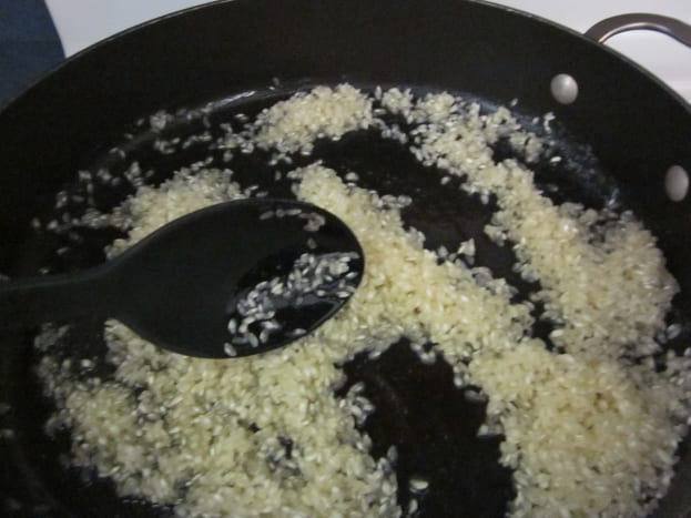 Step 3: Add the rice to the skillet.