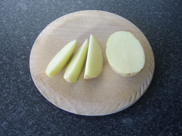 Potato is cut in to six segments or wedges