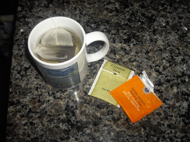 Use any kind of tea. I used one bag of green tea, and one bag of white peach oolong