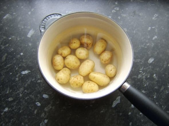 Potatoes are parboiled in their skins