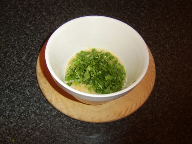 Coriander/cilantro is stirred in to beaten eggs