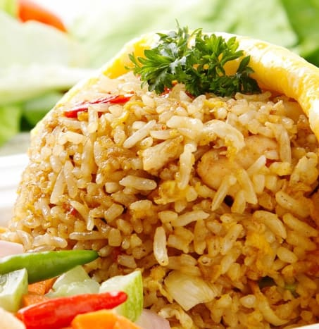 Brown rice is less liable to get soggy in . a salad, and it also brings its own nutty flavor to the dish.
