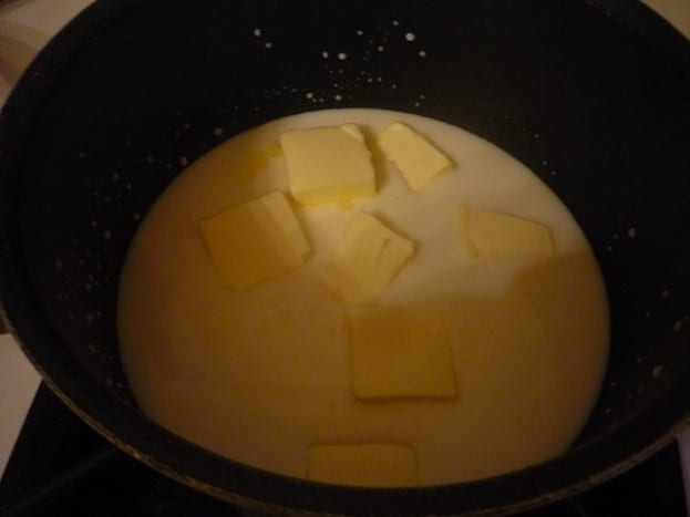 Warm the butter and milk in a saucepan on the stove.