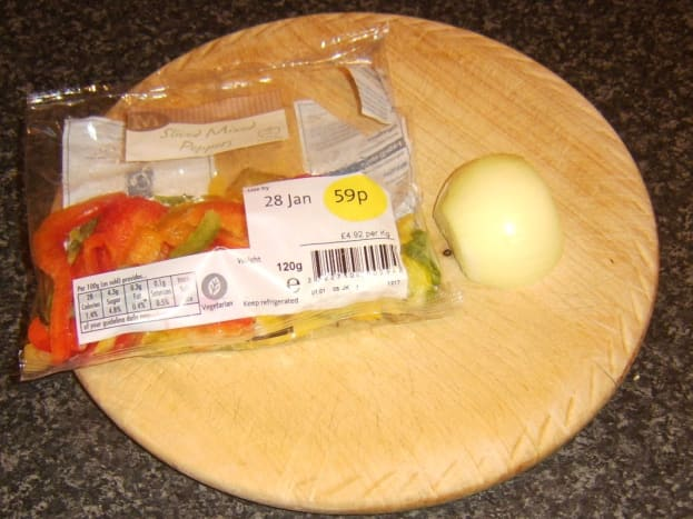 Pack of bell pepper slices and half an onion
