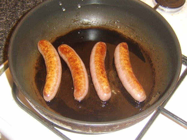Sausages are gently fried in oil
