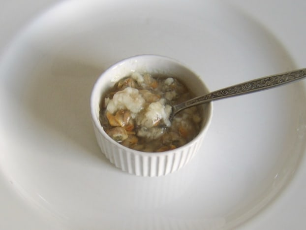 Jellied conger eel and cockles enjoyed simply with malt vinegar and white pepper seasoning