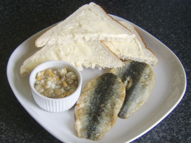 Jellied conger eel and cockles with pan fried herring fillets and bread and butter