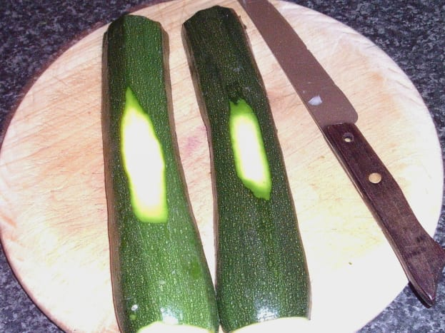 Zucchini skin is shaved to ensure balance on roasting tray