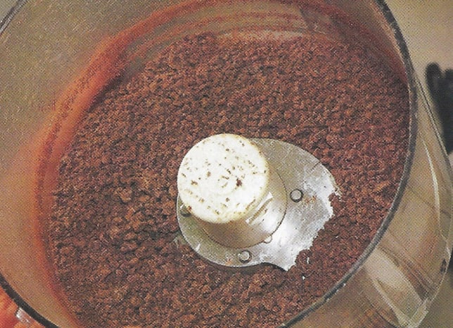Pulverize the chocolate in the bowl of a food processor