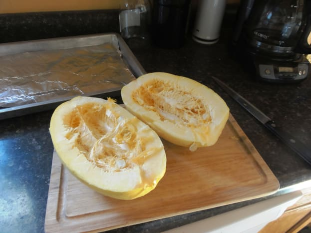 Cut the squash in half.