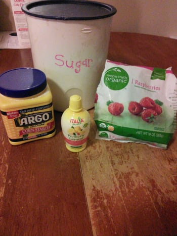 Gather all your goodies. You will need 1 1/2 cups frozen raspberries. (I just bought a 10 oz bag), 1 Tbsp Corn starch, 2 Tbsp lemon juice, and 1 1/4 cup sugar.
