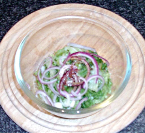 Balsamic vinegar is added to salad