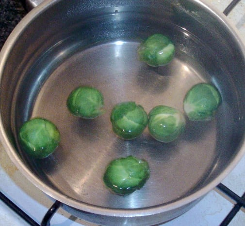 Sprouts are brought to a simmer in salted water