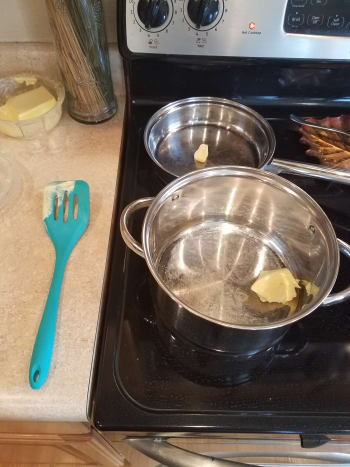 Melt butter into a small saute pan and a large pot.