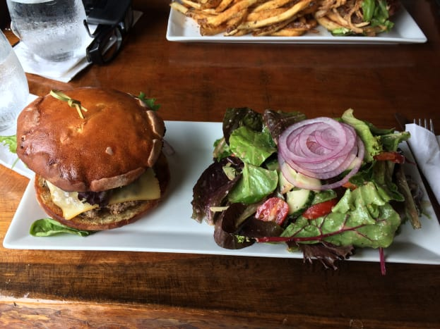 Presentation of burger and salad