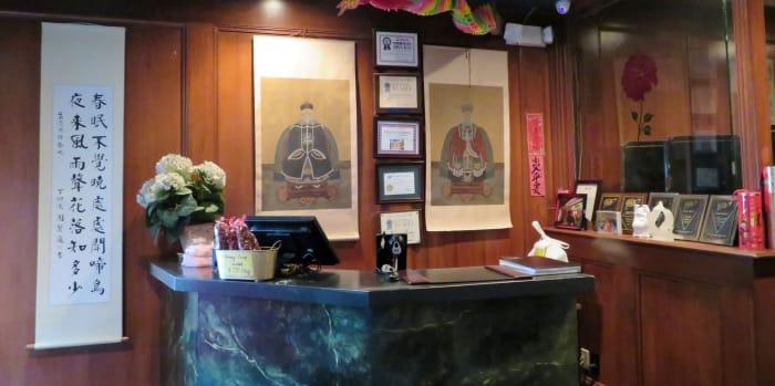 Desk area showcasing numerous awards