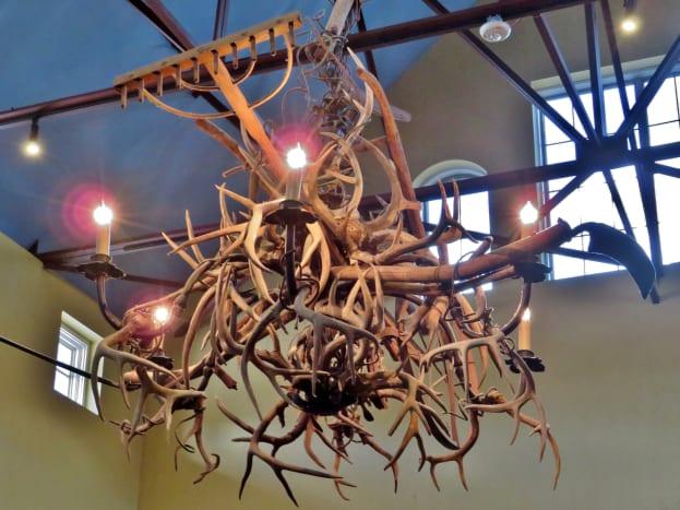 Unique chandelier inside Rio Ranch main dining room