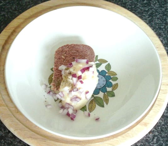 Horseradish sauce and chopped onion is added to corned beef