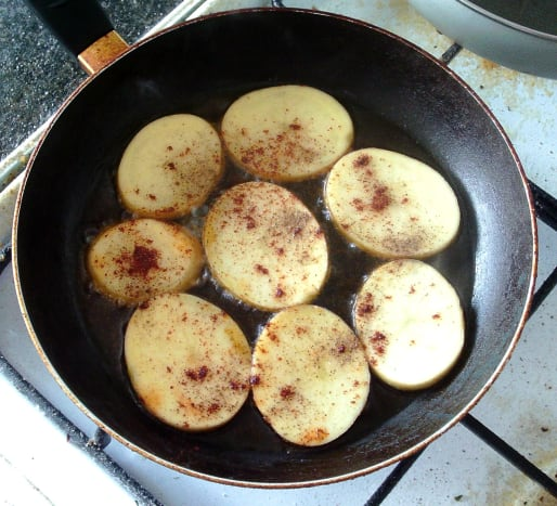 Frying chilli spiced potatoes