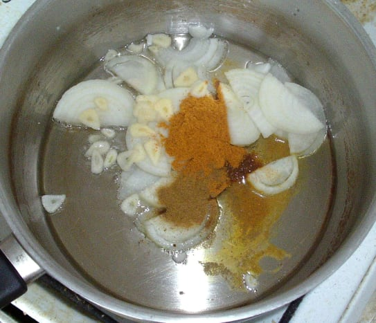 Onions, garlic and spices are sauteed in vegetable oil