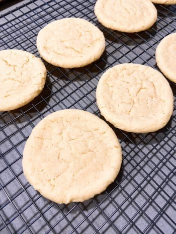 Cool the baked sugar cookies on the wire rack before decorating.