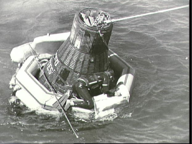 Sigma 7, with flotation collar attached, awaits recovery. Photo courtesy of NASA.