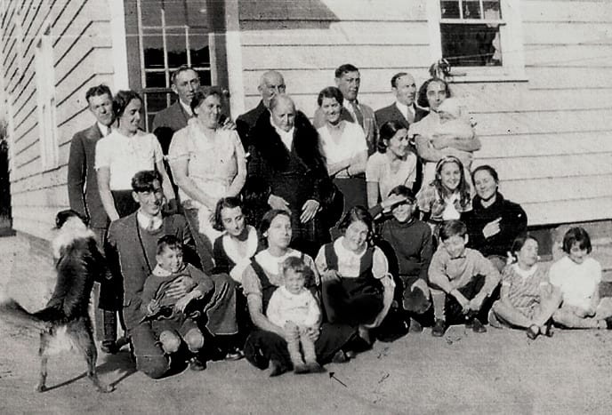 This photo shows Julia with her family in 1933. She is in the front row (see arrow), holding her nephew, David Crotta.