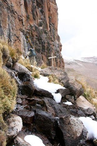 A cross marks the point in the Andes mountains where the Amazon River originates.