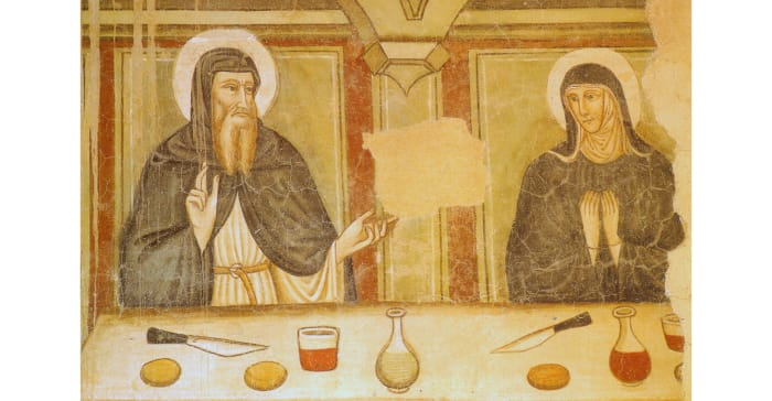 The two holy siblings share a meal and lively conversation.