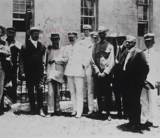 Joseph seen here with distinguished visitors at St. Damien's grave.